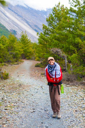 Portrait Young Pretty Girl Wearing Red Jacket Backpack Trail Mountains.Mountain Trekking Landscape Hikking Path View Background.Woman Happy Smiling Close Rock River.Horizontal Photo Stock Photo