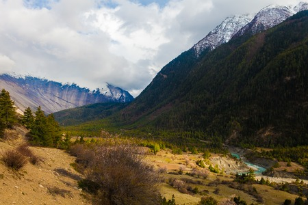 Landscapes Snow Mountains Peak Nature Morning Viewpoint.Mountain Trekking Landscape Background. Nobody photo. Horizontal picture. Sunlights White Clouds Blue Sky.Asia Himalayas Rocks Hikking Sport Stock Photo