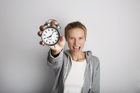 Portrait Handsome Young Woman Posing Blank White Background.Pretty Girl Screaming Holding Vintage Alarm Clock Hand Empty Wall.Beauty Lifestyle Fashion Hipster People.Wake Up Time Abstract Concept