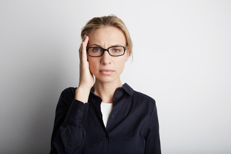 Portrait Handsome Pretty Young Woman Who Grabs Her Head Hands Headache.Empty White Background.Beauty,Stress,Fashion People Photo.Girl Wearing Glasses Closed Eyes Camera Studio Shot.Horizontal Image