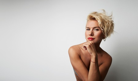Portrait Young Blonde Head Female Perfect Skin Thinking Something Interesting Copy Space Wall Your Business Information or Advertising Content, Smiling and Looking Camera Stock Photo