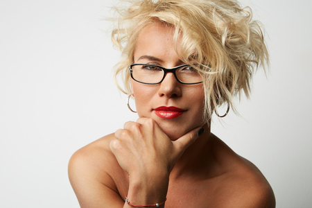 Portrait Young Blonde Head Female Perfect Skin Thinking Something Interesting Copy Space Wall Your Business Information or Advertising Content, Smiling and Looking Camera.Girl Wearing Glasses