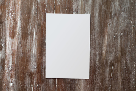 Closeup Blank White Paper Sheet Mockup Natural Wood Table Background. Empty Canvas Painted Brown Desk
