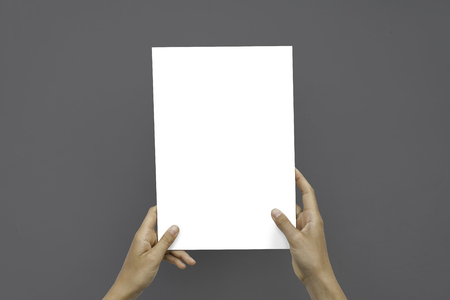 Closeup Blank White Paper Sheet Mockup Holding Female Hands Abstract Gray Background Stock Photo