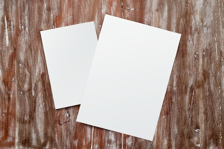 Closeup Two Blank White Paper Sheet Mockup Natural Wood Table Background. Empty Canvas Painted Brown Desk Stock Photo
