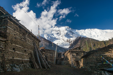 Photo Tracking Himallaya Vilage.View Snow Nepal Mountans Background. Hikking Sport Travel. Horizontal Stock Photo