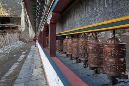 Tibetan prayer wheels or prayers rolls of the faithful Buddhists. Horizontal photo