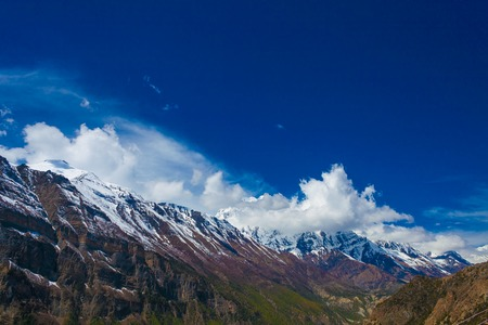 Landscape Snow Mountains Nature Viewpoint.Mountain Trekking Landscapes Background. Nobody photo.Asia Travel Horizontal picture. Sunlights White Clouds Blue Sky. Himalayas Rocks View Stock Photo - 63727208
