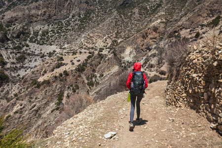 Young Pretty Woman Wearing Red Jacket Backpack Trail Mountains.Mountain Trekking Rocks Path Landscape View Background. Horizontal Photo Stock Photo - 63727239