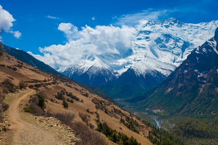 Landscape Snow Mountains Nature Viewpoint.Mountain Trekking Landscapes Background. Nobody photo.Asia Travel Sport.Horizontal picture. Sunlights White Clouds Blue Sky. Himalayas Rocks Stock Photo - 63727278