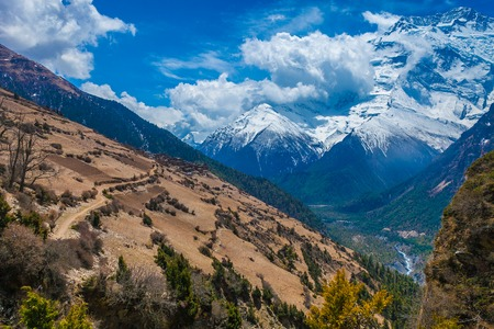 Beautiful Landscape View Snow Mountains Nature Viewpoint.Mountain Trekking Landscapes Background. Nobody photo.Asia Travel Sport.Horizontal picture. Sunlights White Clouds Blue Sky. Himalayas Rocks