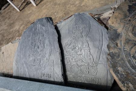 Closeup Photo Autentic Draw Stone Budda Symbols and Mantras. Horizontal. Nepal Travel Trakking Stock Photo - 63727404