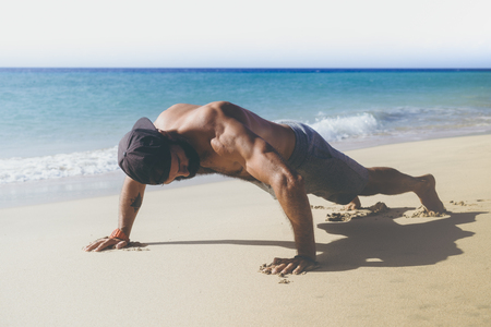 Workout exercise concept.Healthy Handsome Active Man With Fit Muscular Body Doing Push Ups Exercises. Sporty Athletic Male Exercising At Beach. Training Outdoor. Sports And Fitness Concept. Stock Photo - 101096684