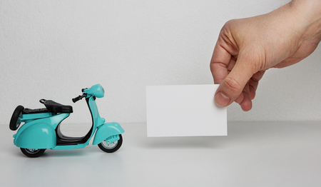 Mockup of blank business card and retro scooter on blank background. Business empty mock-up background for text message writing.Horizontal Stock Photo - 101125205