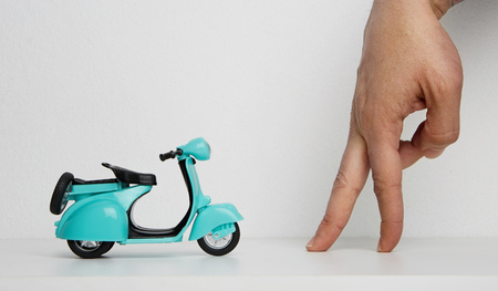 Mockup of blank male hand and retro scooter on blank background. Business empty mock-up background for text message writing.Horizontal