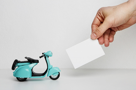Mock-up of blank business card and retro scooter on blank background. Business empty mock-up background for text message writing.Horizontal