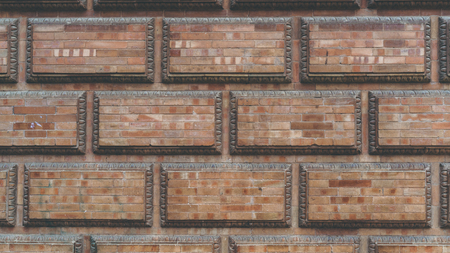 Grunge red brick frame wall background with copy space.Old brick wall, old texture of red stone blocks closeup
