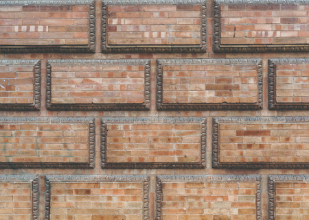 Grunge red brick frame wall background with copy space.Old brick wall, old texture of red stone blocks closeup Stock Photo - 105358625