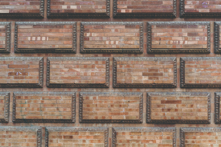 Grunge red brick frame wall background with copy space.Old brick wall, old texture of red stone blocks closeup Stock Photo - 105358626
