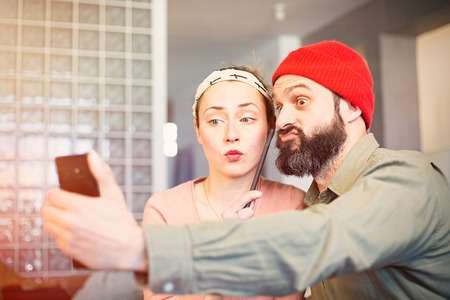 Happy young couple taking selfie photo at home. Romantic relationship between people