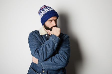 Bearded positive handsome man Wearing blue jeans on white background. Studio shot
