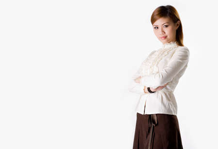 confident female business executive cross hand looking very approachable wearing a white blouse and dark brown skirt smiling