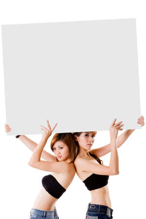 two girls holding up a big sign photo