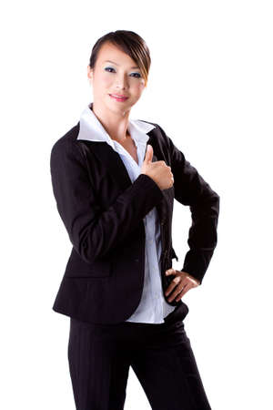 a young female business executive with thumbs up  photo
