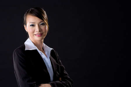 asian business woman on black background photo