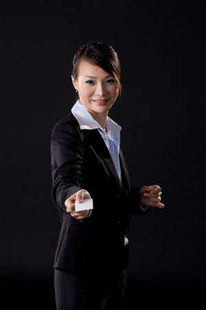asian business woman with white card on black background photo