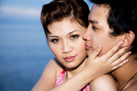 facing the camera: loving couple with the girl facing camera Stock Photo