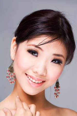 Beautiful asian woman with a sensual smile Stock Photo