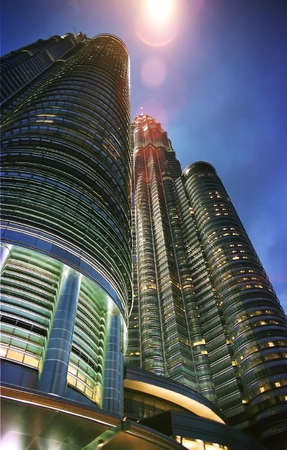 petronas: petronas towers from a low angle with a streetlamp flare