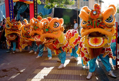 chinese lion dance troupe backlited Stock Photo