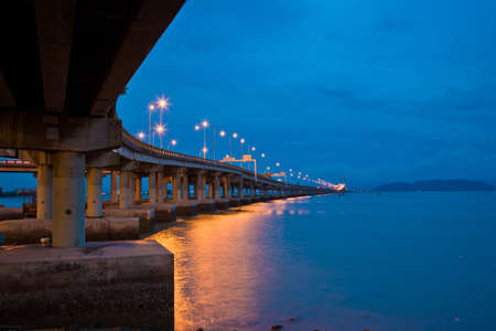 penang: Penang bridge view in the evening with deep blue sky and sea Stock Photo