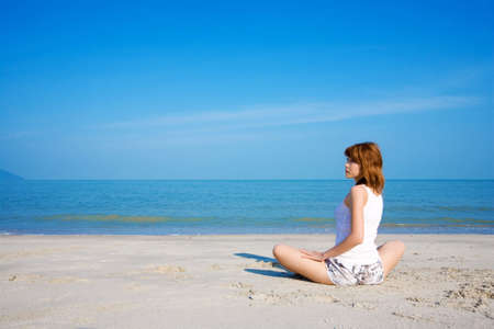 center position: woman realxing look side way by the beach