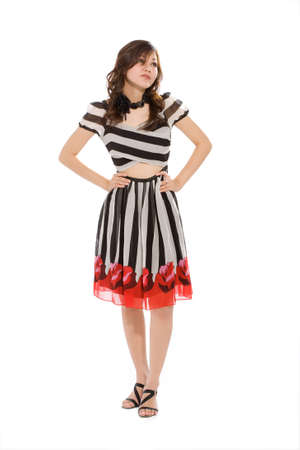standing woman in black and white stripes dress look up while thinking photo