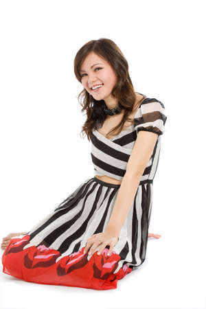 sweet young woman smiling, sitting on the floor photo
