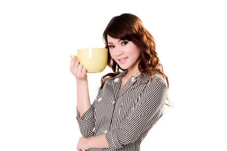 swallowing: young woman holding a big green cup close to her head