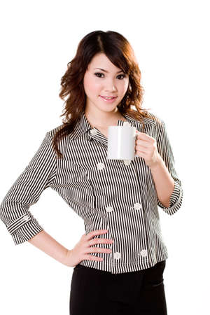 downtime: young business woman holding a mug smiling happily