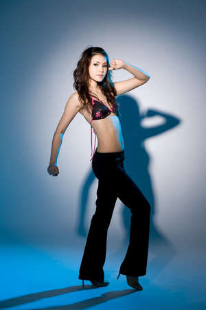 young woman in a club outfit dancing sexily Stock Photo