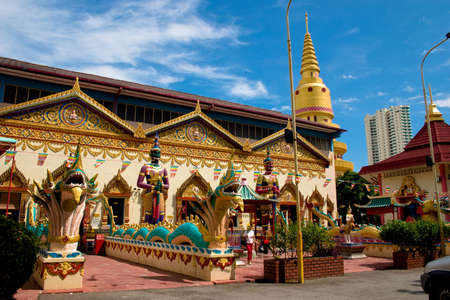 krung: Intricate siamese buddhist temple penang with an oriental stone dragon