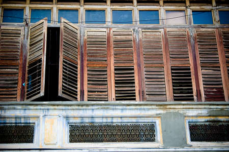 a row of wooden windows with one of the slightly open photo