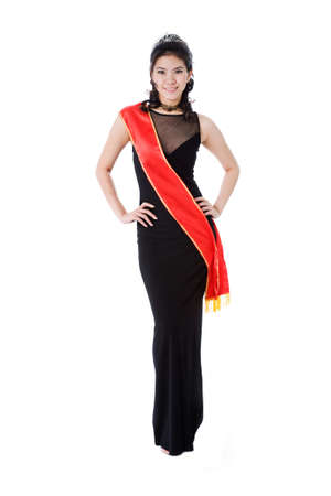 woman friendly smile of a pageant queen wearing red sash