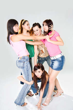 a group of girl friends fighting each other Stock Photo - 2470413