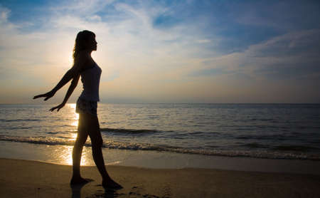 silhouette of a woman doing yoga exercise at sunset Stock Photo - 2591461