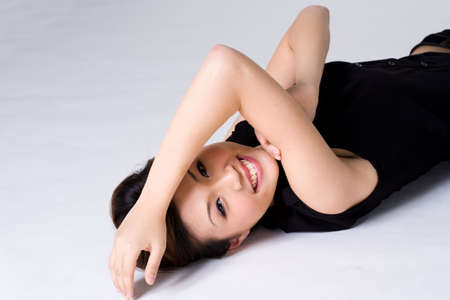 happy alluring woman lying on the ground Stock Photo - 2616462