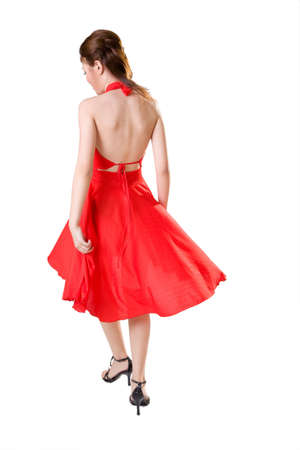 woman in red dress turn around while walking