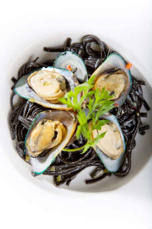 european cuisine: seafood meal of oysters serve with noodles