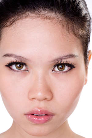 woman face with attractive eyes wearing color contact lens photo